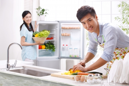 indian cooking: Young couple in kitchen