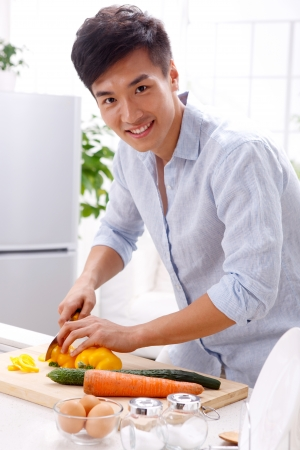 young man in kitchen Stock Photo