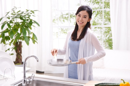 pan asian: young woman in kitchen