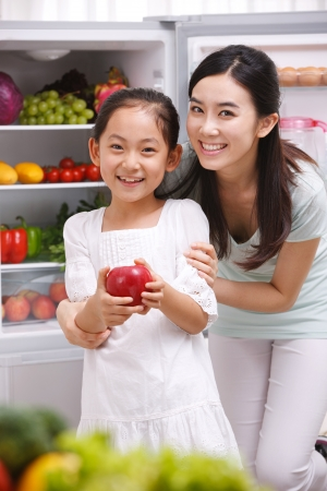 mother and daughter in kitchen Stock Photo - 16191154
