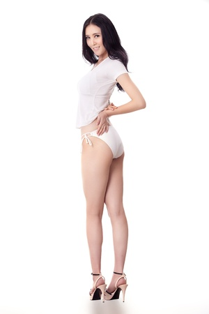 Sexy Asian woman isolated on white background photo
