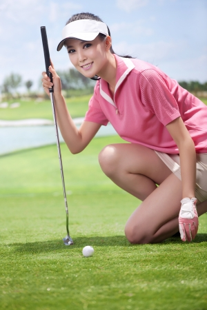Asian woman play golf Stock Photo