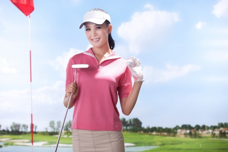 Asian woman play golf photo