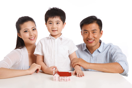 Family with house model Stock Photo - 22520474
