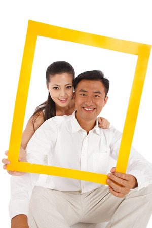 Young couple holding photo frame photo
