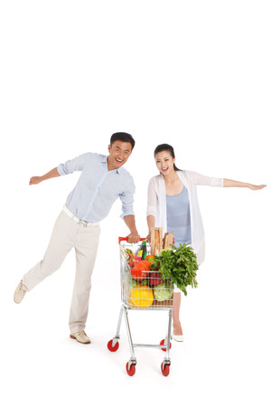 Young couple shopping with shopping cart Stock Photo - 22520476