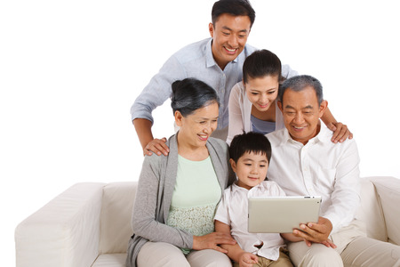 Whole family holding tablet computer photo