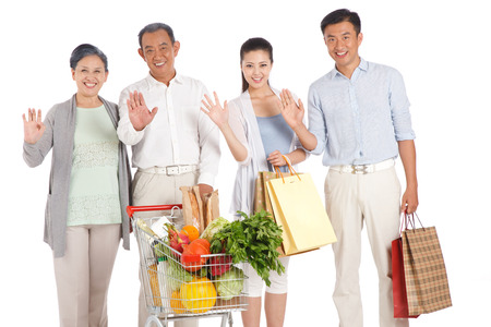 Old couple and young couple shopping with shopping cart Stock Photo - 22520487