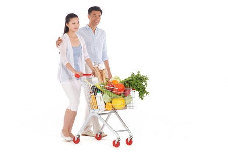 Young couple shopping with shopping cart photo