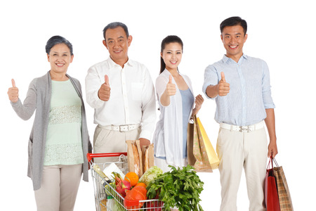 Old couple and young couple shopping with shopping cart photo