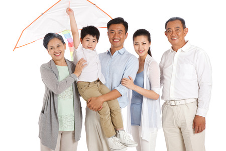 Whole family holding kite photo