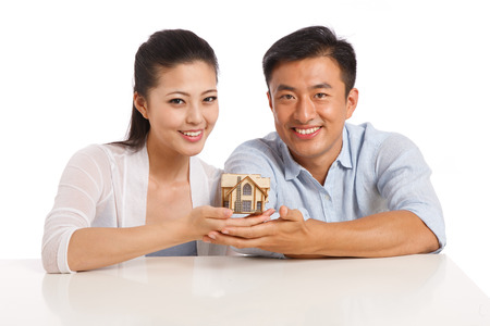 Young couple holding house model photo