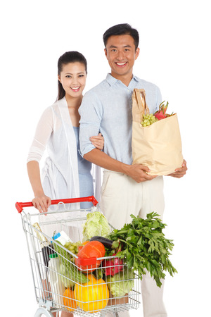 Young couple shopping with shopping cart Stock Photo - 22520557
