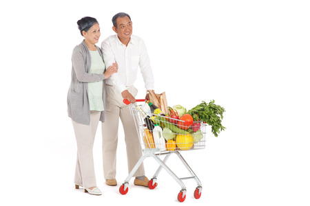 Old couple shopping with shopping cart photo