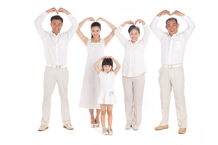Whole family making heart shape with hands photo