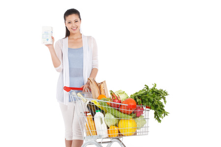 Young woman shopping with shopping cart photo