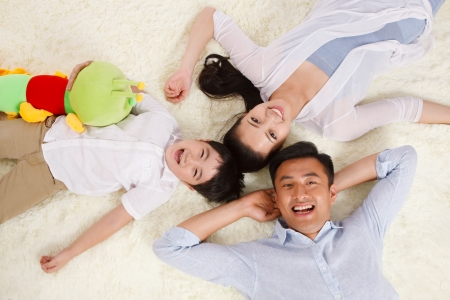 Family lying on floor photo