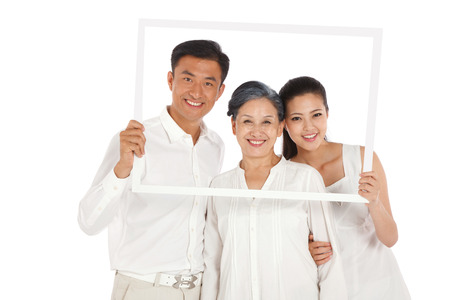 Mother,son and daughter holding photo frame