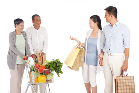Old couple and young couple shopping with shopping cart Stock Photo - 22520713