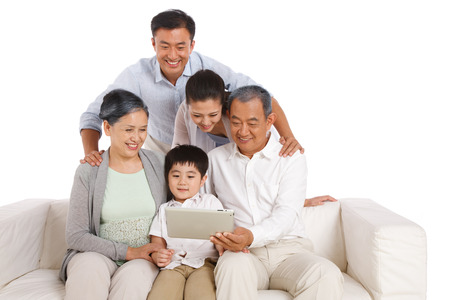Whole family holding tablet computer