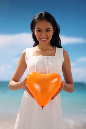 Woman holding heart shape,smiling photo