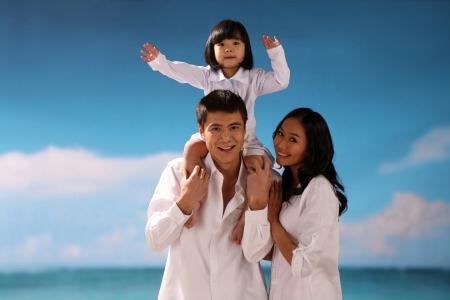 Portrait of family on beach photo