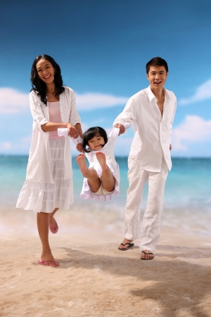Portrait of family on beach Stock Photo - 22752404