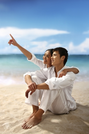 Young couple at the beach,smiling photo