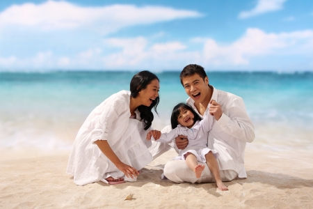 Portrait of family on beach,smiling Stock Photo
