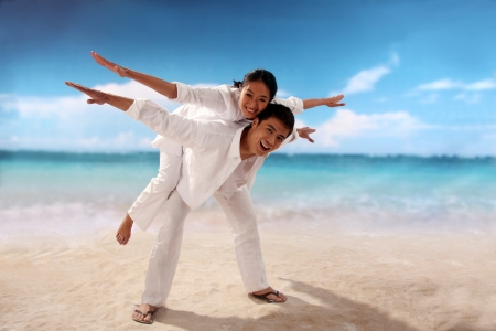 Playful couple at the beach Stock Photo - 22752479