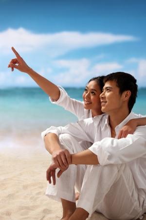 Couple sitting at beach photo