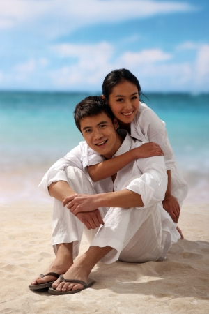 Couple embracing at beach photo