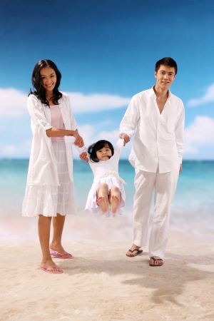 asian family outdoor: Famly of three playing at beach