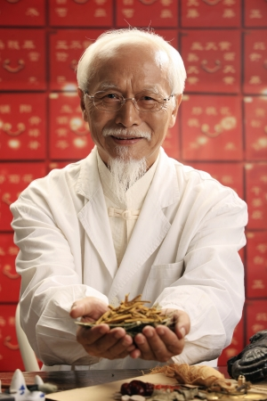 Male doctor holding Vegetable caterpillar photo
