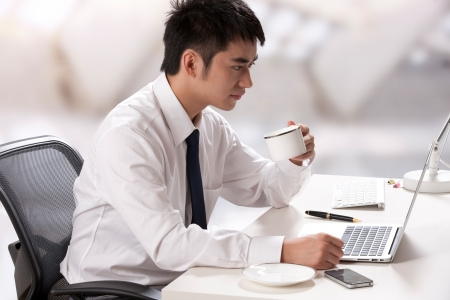 Young businessman using laptop photo