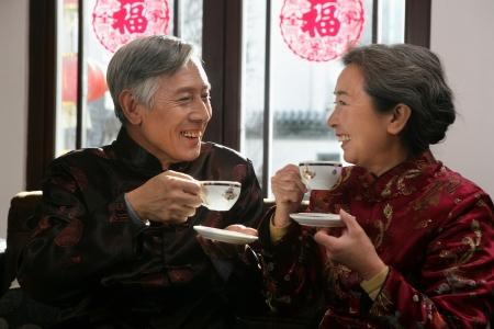 Chinese mature couple drinking tea photo