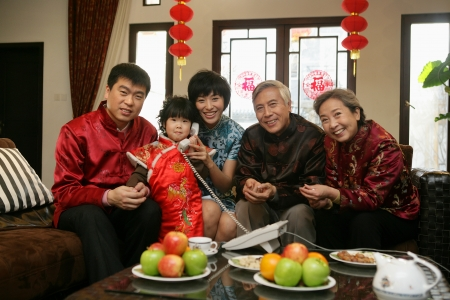 A shot of Chinese family reunion in the house  photo
