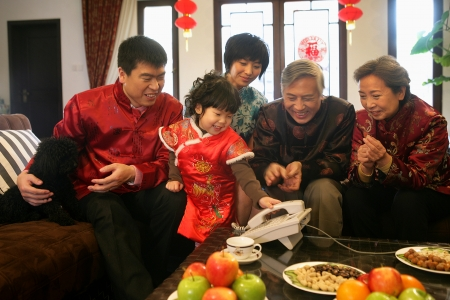A shot of Chinese family reunion in the house  Stock Photo - 23325636