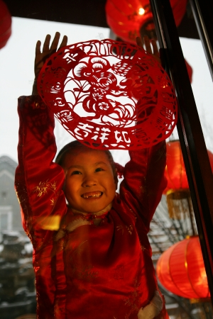 A shot of Oriental Child in Festival Stock Photo - 23325644