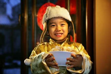 A shot of Oriental Child in Festival Stock Photo - 23325647