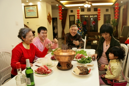 A shot of Chinese family at dinner table photo