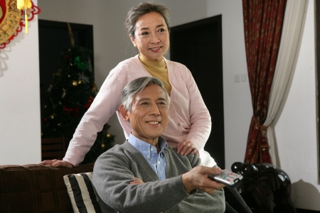 Chinese mature couple watch TV photo