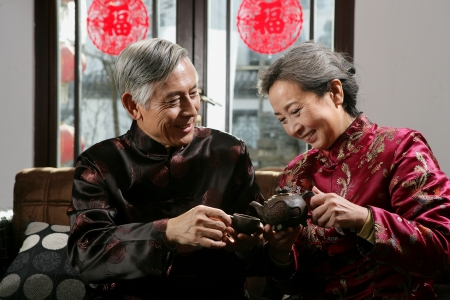 Chinese mature couple drinking tea photo