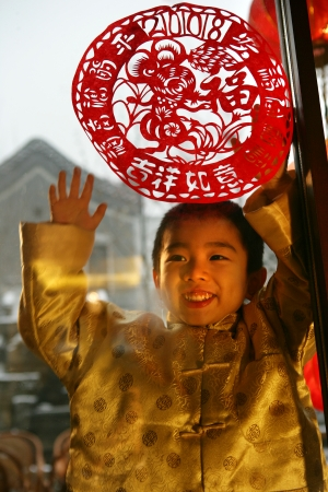 A shot of Oriental Child in Festival Stock Photo - 23325886