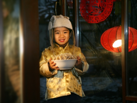 A shot of Oriental Child in Festival Stock Photo - 23325895