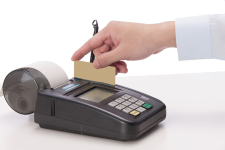 A shot of Credit card and POS machine photo