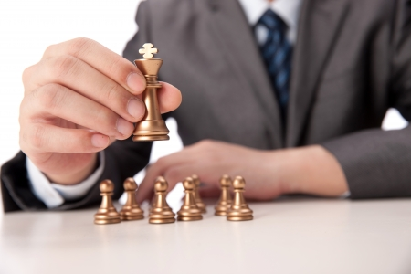 A shot of Businessman holding chess item