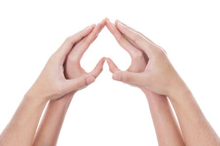 A shot of Hands making heart shape photo