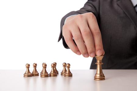 A shot of Businessman holding chess item photo