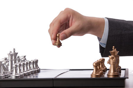 A shot of Businessman playing chess photo